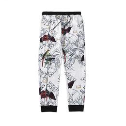 huellas de animales Rebajas Pantalones de chándal de diseñador para hombre Marcas casuales de cremallera Escultura y Animal Print Pantalones Hip Hop Streetwear Pantalones sueltos Hombres Joggers de lujo