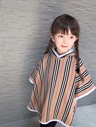 Ponchos de punto para niños online-Nuevo 2019 Baby Girls capa Ropa manto borlas de lana niños de punto capa chaqueta de la muchacha Engrosamiento cálido prendas de abrigo 2-15years