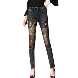 1735ca19821a3 Women s Autumn Patch Hole Small Pants Long Women Jeans Sexy Vintage Women  Slim Jeans Pants With Embroidery Sequined Pencil