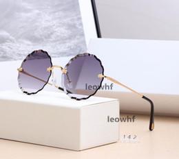 Wholesale 2019 marca redonda rosie octogonal óculos de sol para as mulheres full frame óculos de proteção esporte ao ar livre moda óculos de sol retro eyewear com caixa