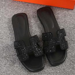 Pantofole piane del rhinestone online-moda femminile estate 2019 2019 Edizione coreana estiva Scarpe con fondo piatto selvaggio Sandali e pantofole in strass a una linea