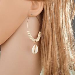 Pendientes de concha natural, estilo boho, pendientes de cuentas beige, mayorista de lujo, joyas de diseño, pendientes para las mujeres de Europa y América. desde fabricantes