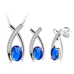 Ciondolo croce cristallo blu online-Alta qualità Costume blu scuro pietra ciondolo gioielli set croce gioielli in cristallo collana orecchino di nozze