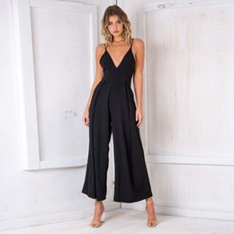 75a99d2363b Casual Strap Backless Long Jumpsuits Summer 2018 Sexy V-Neck Back Bow  Rompers Solid Flare Trouser Women Overalls Loose Plus Size
