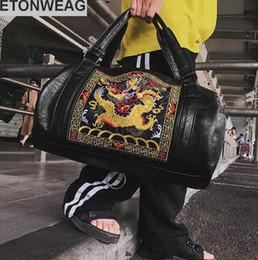 bolsos de la marca china Rebajas Venta directa de fábrica de los hombres de la marca paquete de estilo chino bordado tótem hombres bolso de hombro Street tendencia chino de cuero dragón