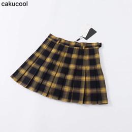 Viento de la universidad Four Seasons Cientos juegos de cintura alta Delgado amarillo a cuadros cien pliegues falda antidesgaste en forma de falda de tenis desde fabricantes