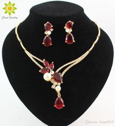 2019 diseños de oro rubí 18K chapado en oro negro / azul / rojo / púrpura Zircon Beads Crystal colgantes collar pendientes conjuntos moda mujer partido sistemas de la joyería