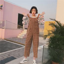 6c764d8b064 Korean Ulzzang Preppy Style Female Overalls Japanese Vintage Casual Loose  Plaid Wide Leg Women Strap Pants Harajuku Jumpsuits