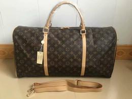 6c03510a6d5a 55 CM de gran capacidad mujeres bolsas de viaje famoso diseñador clásico  venta caliente de alta calidad hombres hombro bolsas de lona llevar en el  equipaje