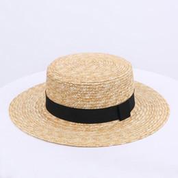 Chapéu pequeno britânico on-line-2019 nova venda quente conforto selvagem palha chapéu de palha feminino primavera e verão arco pequeno chapéu Britânico retro sombra maré praia