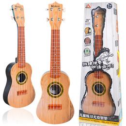 Instrumentos de guitarra china online-Los niños estudian la guitarra de plástico colorido hermoso ukelele principiante instrumentos musicales juguetes Tuba 21 pulgadas requiere batería Venta caliente 32blb1