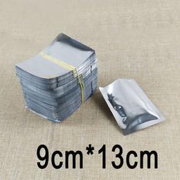 Sacchetti laminati online-500pcs 9cm * 13cm sacchetto d'imballaggio laminato del sacchetto piano alluminizzante adatto di alta qualità