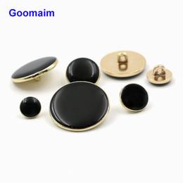 Canada 100 pcs / lot 9 mm de haut grade vêtement noir huile or côté boutons en métal noir bouton en métal noir boutons de couture pour costume pantalon Offre