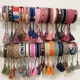 material de la cuerda de lujo de estilo pulsera tejida con las palabras de coser y mano borla marca de joyería de la correa para las mujeres regalo desde fabricantes