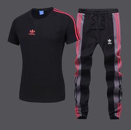 Мужские спортивные костюмы Мода Активные полосатые вышивки Дышащие футболки с круглым вырезом Пуловер Футболки с длинными брюками Размер смеси хлопка S-2XL от