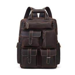 Mochila de bolsillo de cuero online-Mochila de cuero COWHIDE más bolsillo Monedero de alta calidad Bolsos de diseño Bolsos de viaje de cuero genuino portátiles