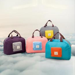 Fábrica al por mayor versión coreana bolsa de avión plegable almacenamiento a prueba de agua capacidad estupenda bolsa de viaje bolsa de equipaje de mano de nylon creativo desde fabricantes