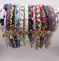 2019 portachiavi in pelliccia bianca 60pcs colori misti in pelle PU O portachiavi personalizzato cerchio nappa braccialetto braccialetto portachiavi portachiavi donna ragazza portachiavi cinturino da polso