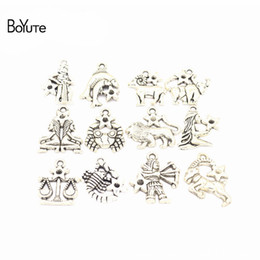 BoYuTe (12 Pieces/Set) Metal Alloy 23*21MM Zodiac Signs Charms Pendant Diy Hand Made Jewelry Accessories cheap zodiac metal signs от Поставщики знаки зодиакального металла