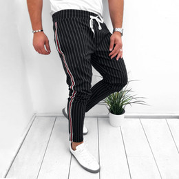 Длина лодыжки мужские спортивные штаны в полоску хип-хоп трек брюки уличная одежда узкие бегунов эластичная талия мужские повседневные брюки 3 # cheap elastic ankle trousers от Поставщики эластичные штаны для брюк