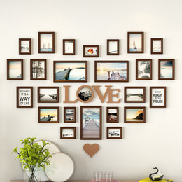 Moderne wanddekoration fotorahmen online-Romantische herzförmige Bilderrahmen Wanddekoration 25 teile / satz Hochzeit Bilderrahmen Wohnkultur Schlafzimmer Kombination Rahmen Set
