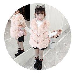 2020 chaleco de piel sintética envío gratis ropa exterior gruesa chaleco sin mangas de imitación de piel de invierno artificial estilo de Corea del envío libre para las niñas chaleco de piel sintética envío gratis baratos