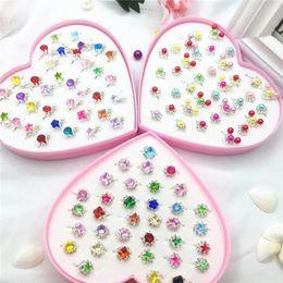 Mini juguetes para niñas online-Favor Mini anillos de dibujos animados fiesta de cumpleaños de los niños para Niños Niñas sorteos Piñata Kinder juguete de regalo del partido del bolso