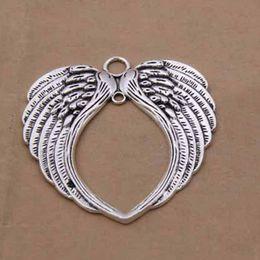 Collar de alas de corazón colgantes online-aleación de las alas del ángel encanta los encantos del corazón de plata antiguos colgante para el collar de la joyería que hace resultados 66x69mm