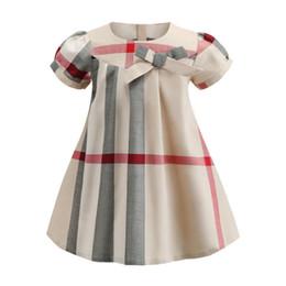 Argentina 2019 primavera verano ropa para niños a cuadros estilo bristish niñas de manga corta vestido de algodón suave moda ropa de las niñas occidentales con arco supplier spring western girl clothing Suministro