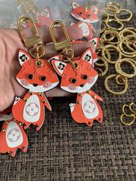 2019 charme libellule rouge 2020 nouveau classique Keychain Porte-clés Porte-clés année Titulaire de la chaîne de clé de rat Porte Clef cadeau Hommes Femmes Souvenirs Sac voiture avec boîte W90