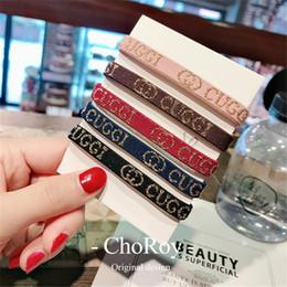 Porta cola online-Carta de moda Impreso Bandas de goma para el cabello Diseño de marea Elástico Mujer Joyería para el cabello Personalidad Nylon Girl Pony Tail Holder