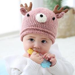 9c6b301a24708 Bébé petit cerf laine chapeau chaud types colorés doux hiver mignon chapeau  de bande dessinée Tricotée chapeau de fourrure garçons filles bons enfants  ...