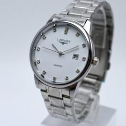 Relógios de marca de homens populares on-line-Popular homens e mulheres assistem relógio top proprietário da marca famoso relógio de moda casual homens e mulheres de aço inoxidável mostram data relógio de quartzo Relogio