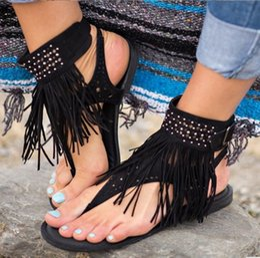 2019 sandalias planas borla marrón Sandalias bohemias de gran tamaño con remaches de remache estilo romano mujer talón plano gladiador sandalias zapatos negro beige marrón rebajas sandalias planas borla marrón