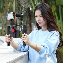 2019 mini transmisor de cámara PULUZ 4 en 1 Vlogging Transmisión en vivo Teléfono inteligente Rig Manija Realización de películas Estabilizador de grabación Kits de soporte de aluminio para teléfono