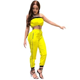 Ropa de mujer Personalidad Vendaje Blusa Chaqueta y pantalones rectos Traje de ocio amarillo Correas de moda Empalme Mujeres Traje de dos piezas desde fabricantes
