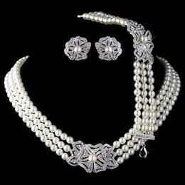 Canada Élégant argent rhodié ivoire perle strass cristal collier boucles d'oreilles avec bracelet ensembles de bijoux de mariage floral Offre