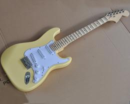 guitarras festoneadas Rebajas Fábrica al por mayor de la guitarra eléctrica de color amarillo con cabezal oferta, incrustaciones de abulón, festoneado de mástil de arce, la tuerca de latón, que ofrece servicios personalizados