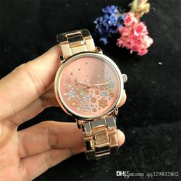 Marcas de relojes de señoras baratas online-Diamante relogio feminino nueva Dama de la moda Diseño Rosa Vestido de oro Señoras de la marca de gama alta relojes Mujer tira de acero precio caliente barato buen reloj
