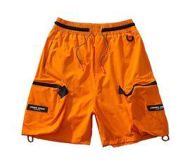 Pantalones cargo naranja online-Hip Hop múltiples bolsillos holgados pantalones cortos para hombre de Calle de verano de los pantalones cortos casuales de la moda masculina Pantalón Orange