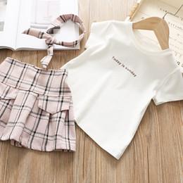Argentina Manga corta Camisas blancas + Faldas a cuadros para niñas Niños Verano 2019 Niños Boutique Ropa 1-6T Niñas 2 PC Conjunto de alta calidad Suministro