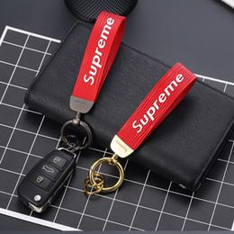 Llavero toyota cuero online-Accesorios para el coche hombres llavero de cuero de regalo de negocios Auto llavero Titular de Nissan Toyota Porsche SAAB Suzuki BMW Volvo clave