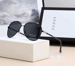 2019 caixa superior de vidro Óculos de sol de luxo designer sunglsses estilo da marca de óculos de sol para homens verão vidro uv400 com caixa e marca logotipo 10012 new chegar hot top caixa superior de vidro barato