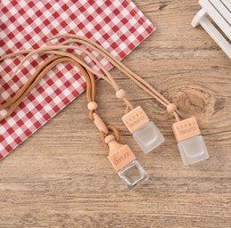 Botella de cristal esencia online-6 ml Coche Colgar Decoración Esencia de vidrio Aceite Botella de perfume Recargable Vacío Colgar Cuerda Botella vacía RRA1992