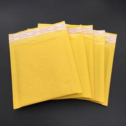 Postage on-line-Atacado- 5pcs (13 * 13 + 4cm) Amarelo Kraft Envelope Bubble Mail Envelope Bag Bolha Postage Packing Envelope Embalagem Saco de Transporte