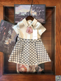 2019 photos de vêtements de baptême Robe en queue de poisson motif de style pastoral Jupe vêtement enfants Fonds d'été pur coton Lattice Girl 0324