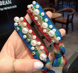 Élastiques de couleur perle en Ligne-10pcs Perles avec la couleur brillante ligne Bands cheveux caoutchouc Mode Femmes Perles ROTULE Corde Bijoux Accessoires pour cheveux