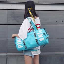 f60f0c855f Hot women duffel bags pink letter beach travel bag high quality nylon  waterproof 5 colors large capacity designer outddor shoulder bag