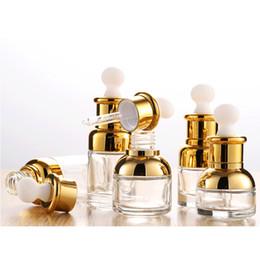 Cuentagotas de oro online-Oro vidrio con gotero 20 30 50 ml botella de suero de lujo con el casquillo de oro de aceite esencial