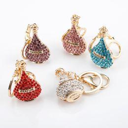 encantos cintilantes Desconto 5 cores Rhinestone cristal Twinkling Frasco de perfume Keychain Presente Para As Mulheres Namorada Bolsa Charme Keyring de llaveros